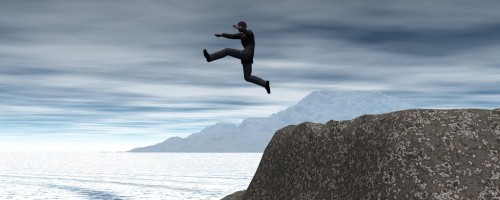 image of a man jumping off a cliff to reach his future